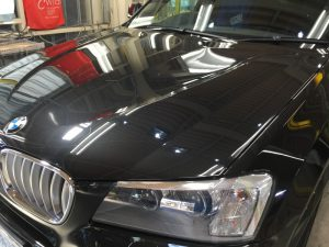 BMWX3・ジーゾックス・ハイドロフィニッシュ施工後の助手席側ヘッドライト付近